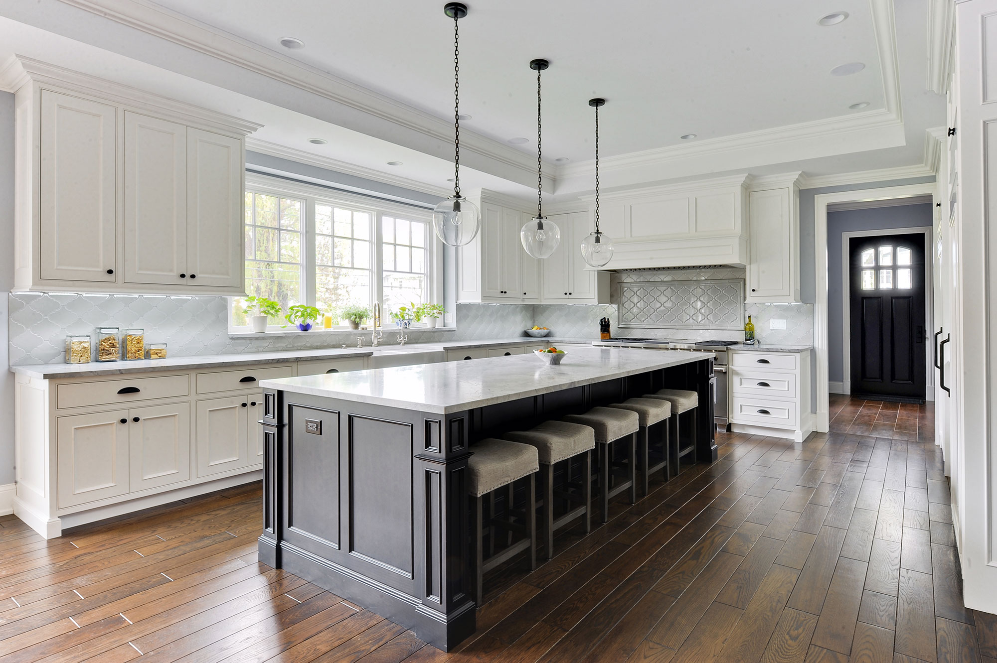 Kitchen With Wood Cabinetry, Granite Countertops, And Stainless Steel  Appliances