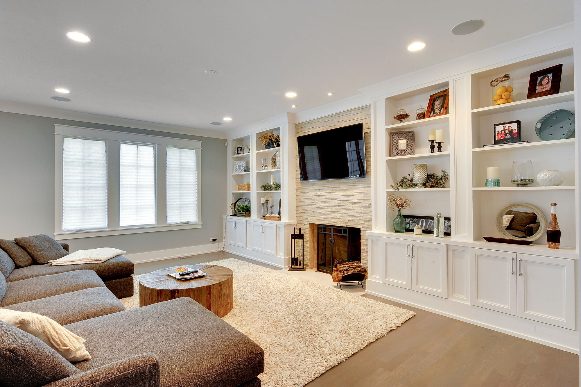 family room with custom millwork and fireplace transitional blue