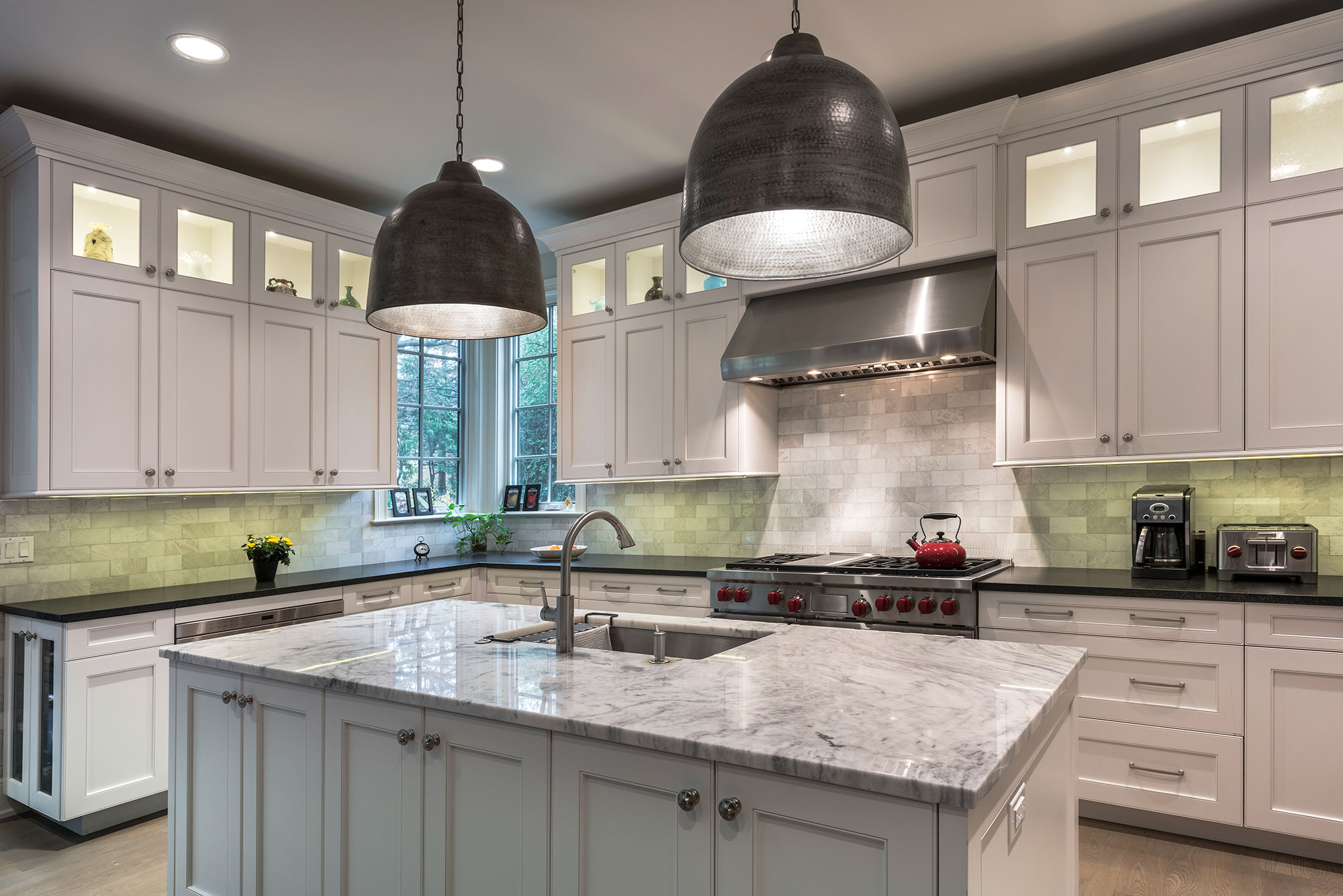 Kitchen With Custom Wooden Cabinetry, Stainless Steel Appliances, And  Granite Countertops