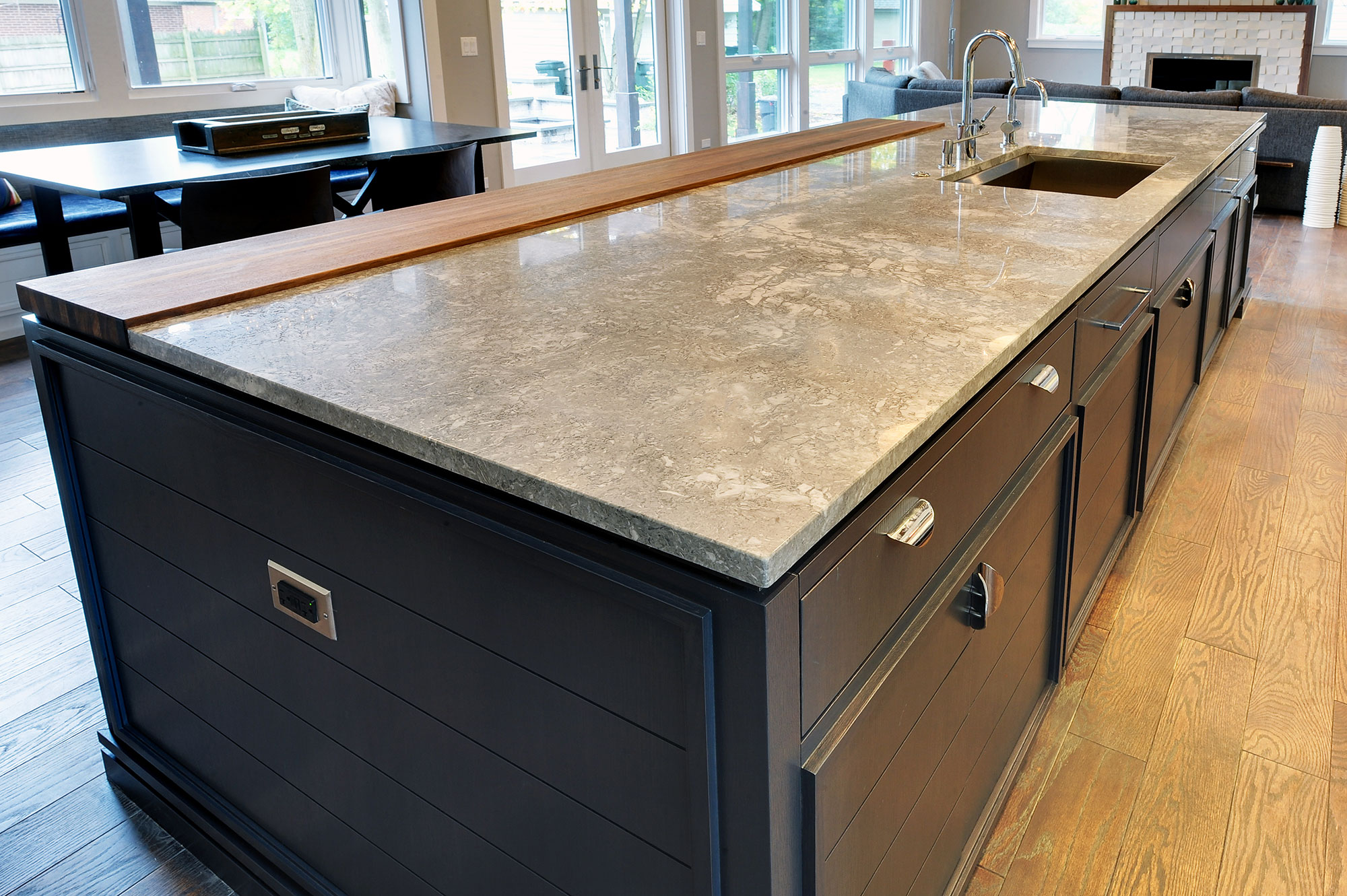 Kitchen Island Close Up With Granite And Wood Countertop