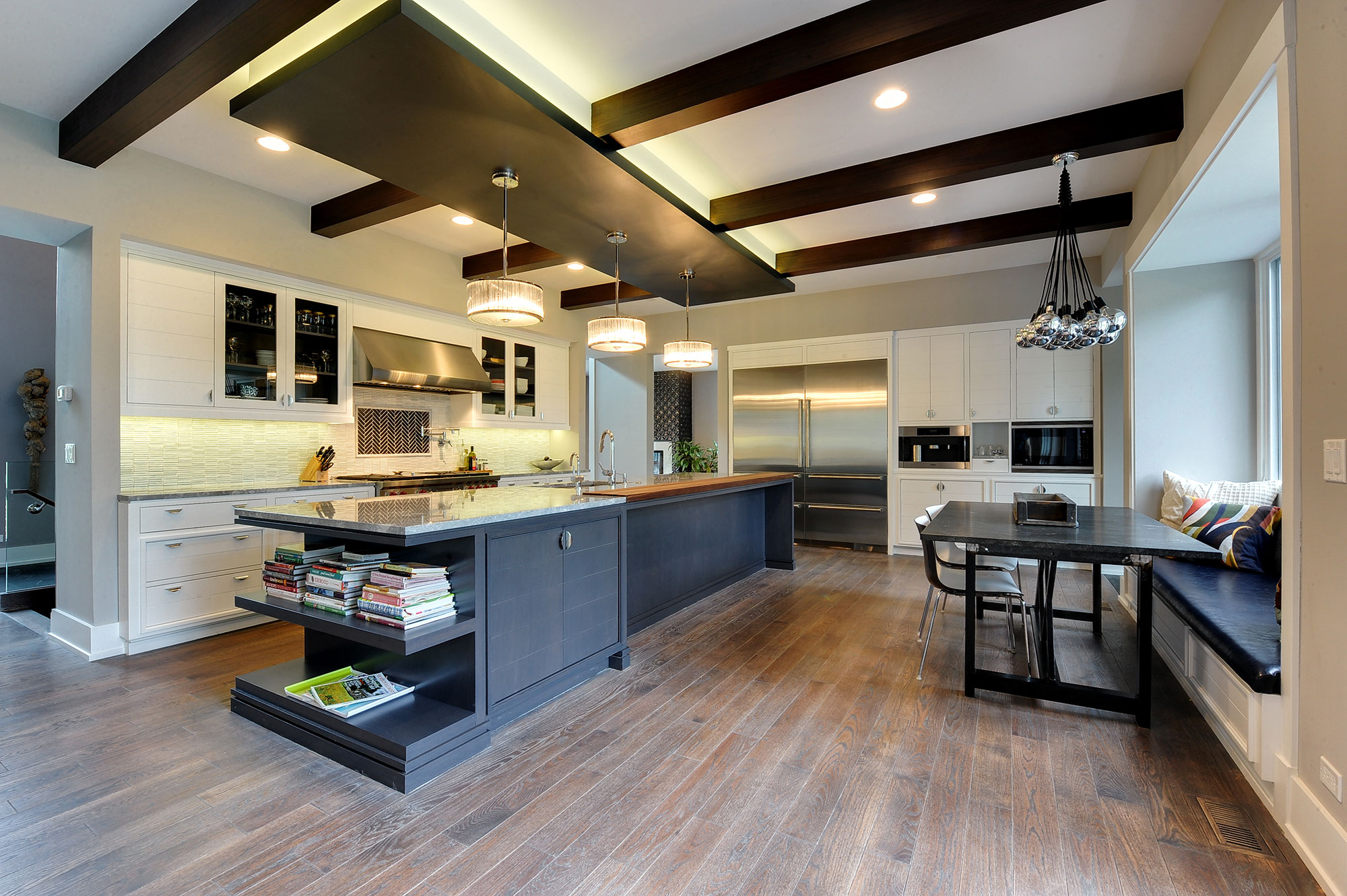 Modern Kitchen With Wooden Beams, Granite Countertops, And Stainless Steel  Appliances, Eclectic Modern