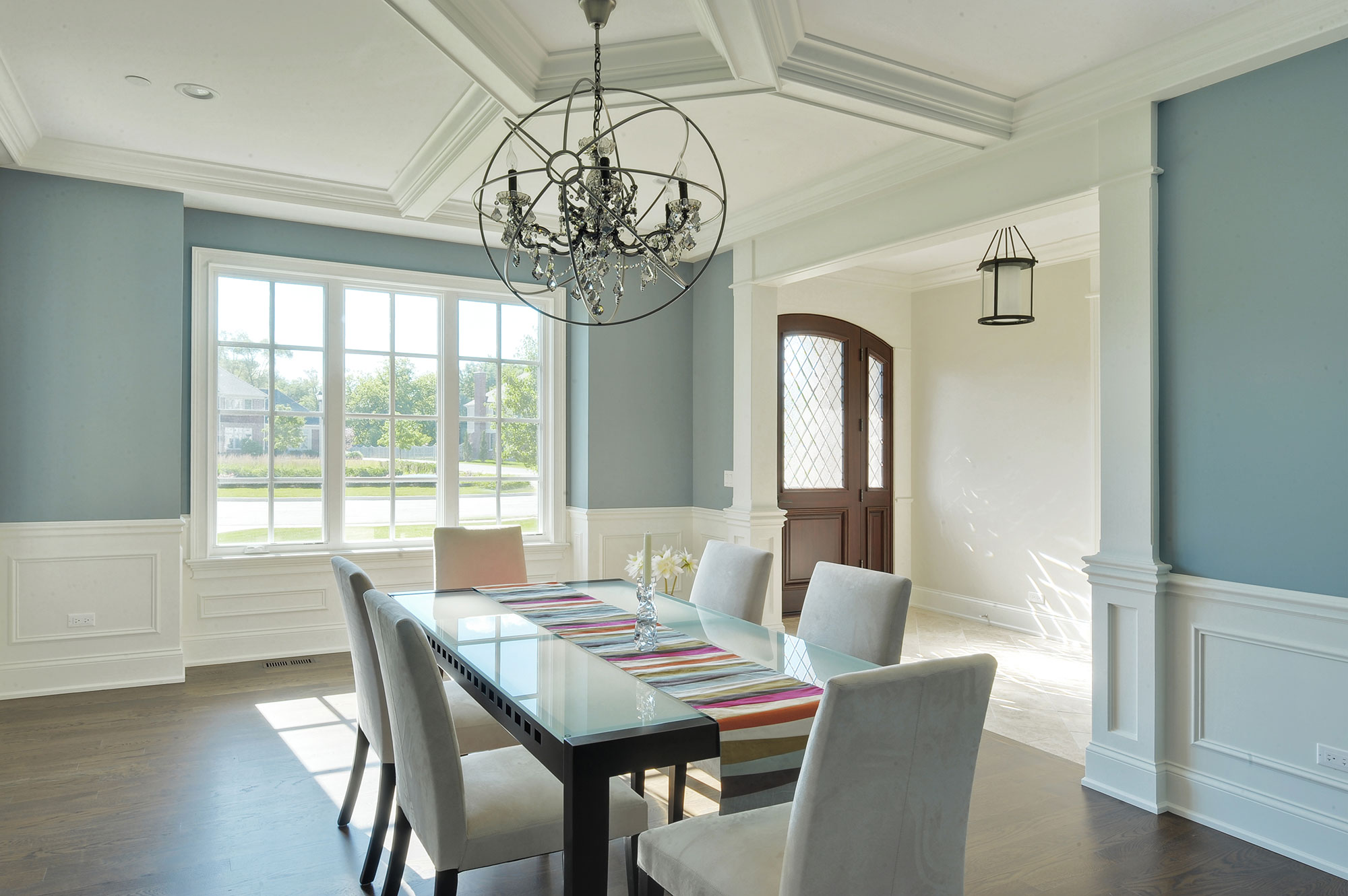 Dining Room With Ceiling Trim Detail And View Of Solid Wood Entry Door