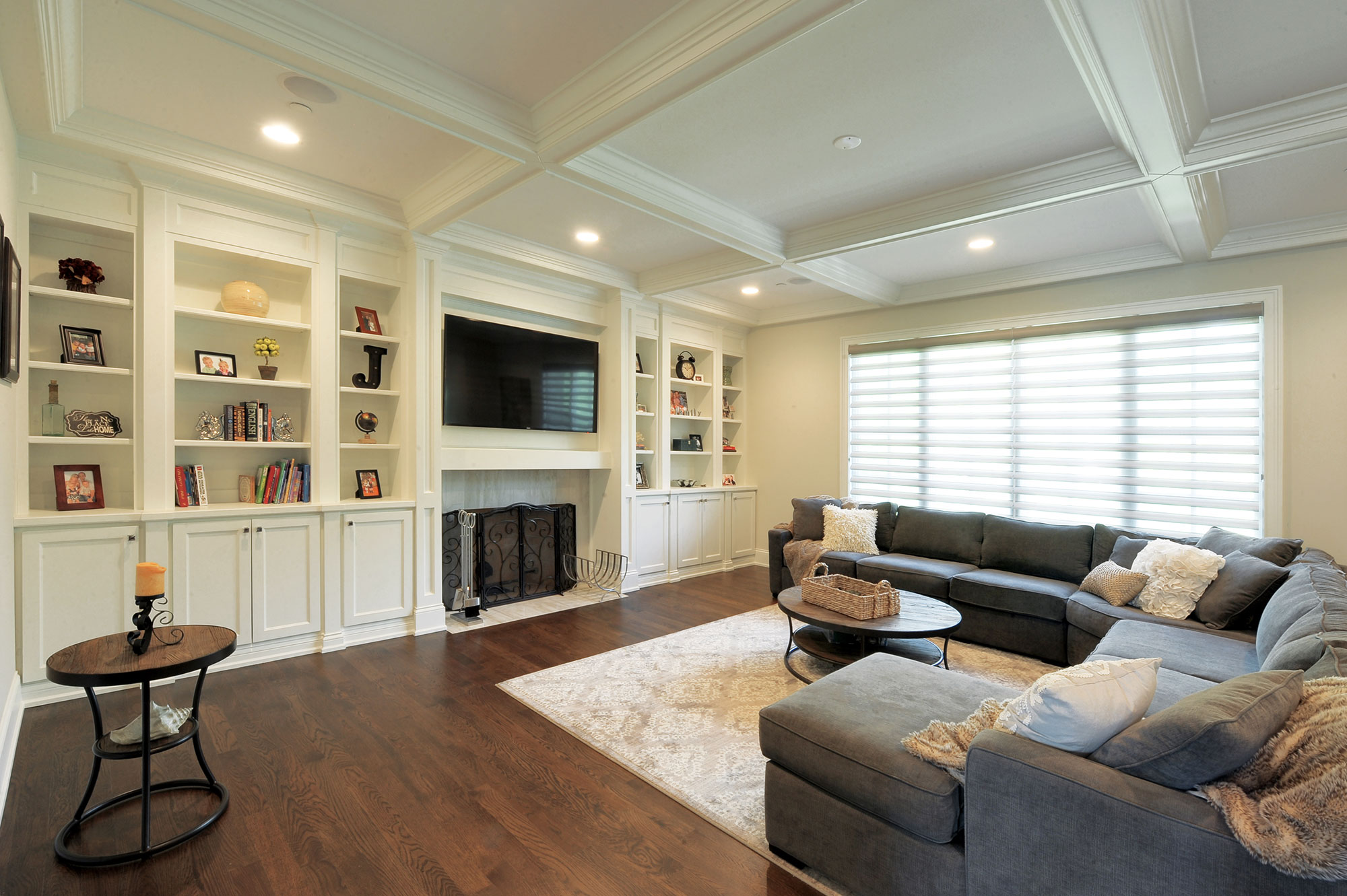 Family Room With Custom Millwork And Ceiling Trim Detail