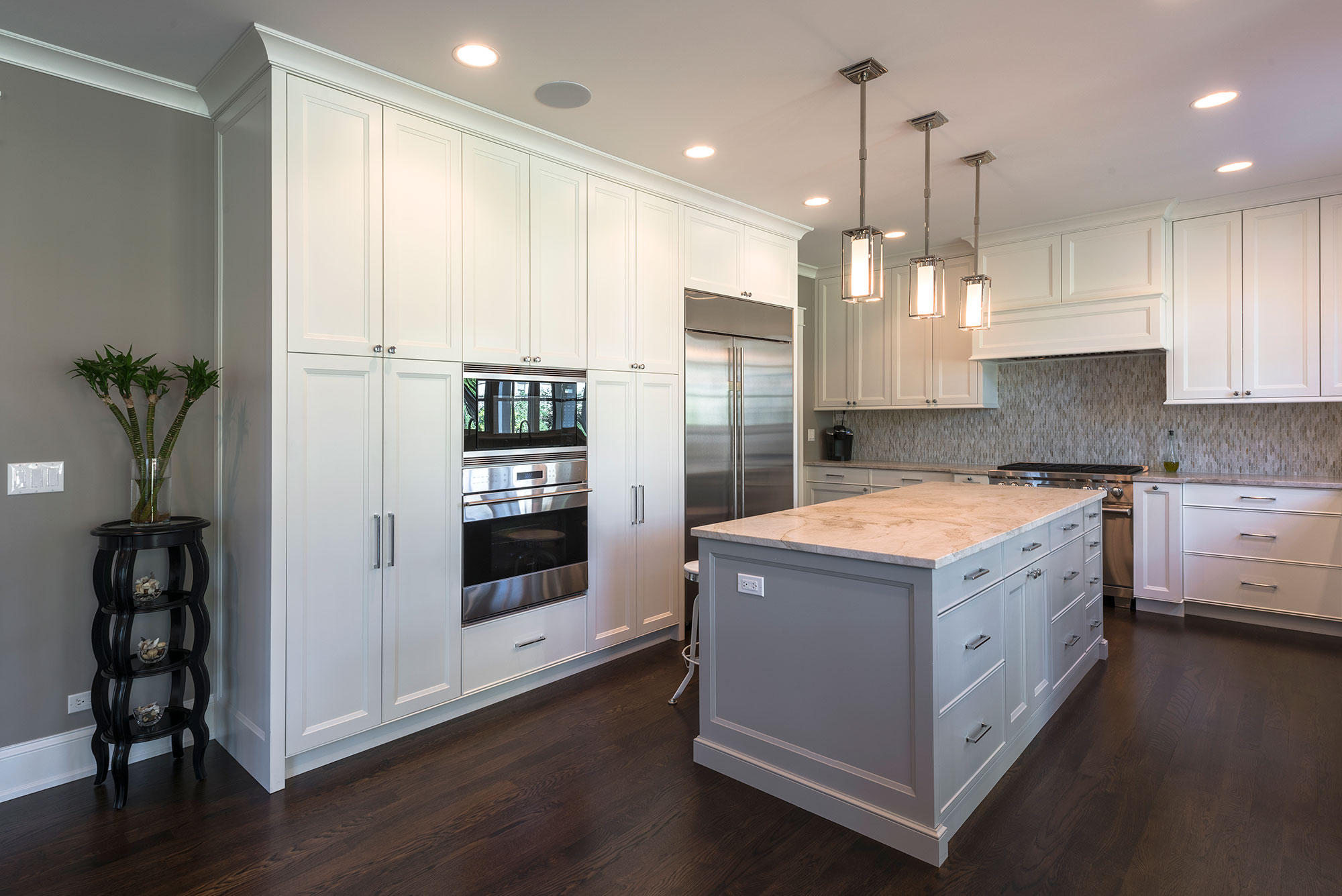Kitchen With Wooden Cabinetry, Granite Countertops, And Stainless Steel  Appliances