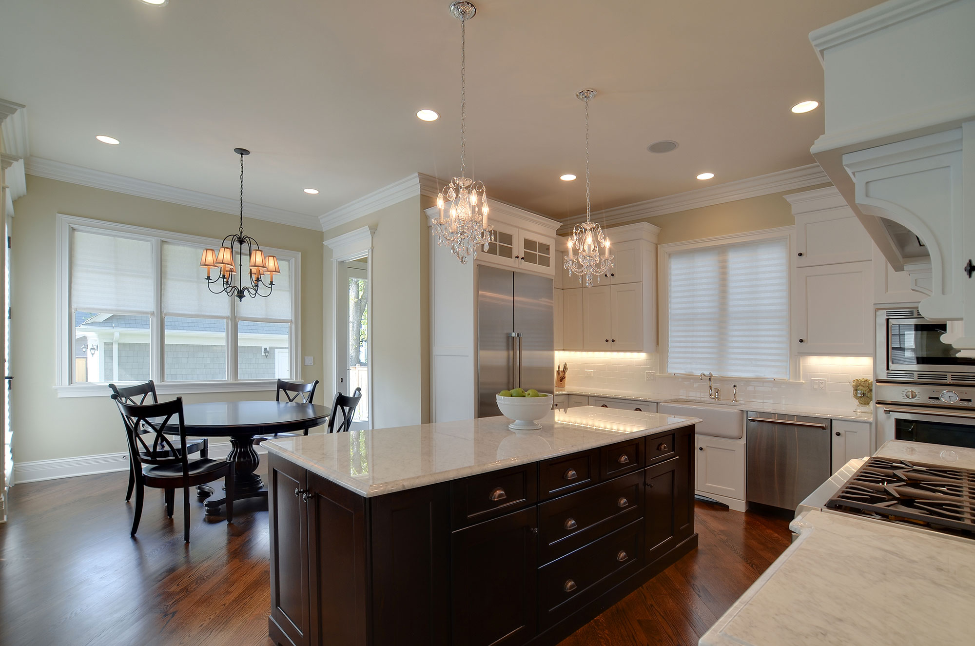 Superb Kitchen With Wood Cabinetry, Granite Countertops, Island, And Stainless  Steel Appliances