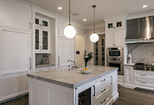Glenview-Coastal - Kitchen, Island, Fridge, Stove, Pantry Door - Globex Developments Custom Homes