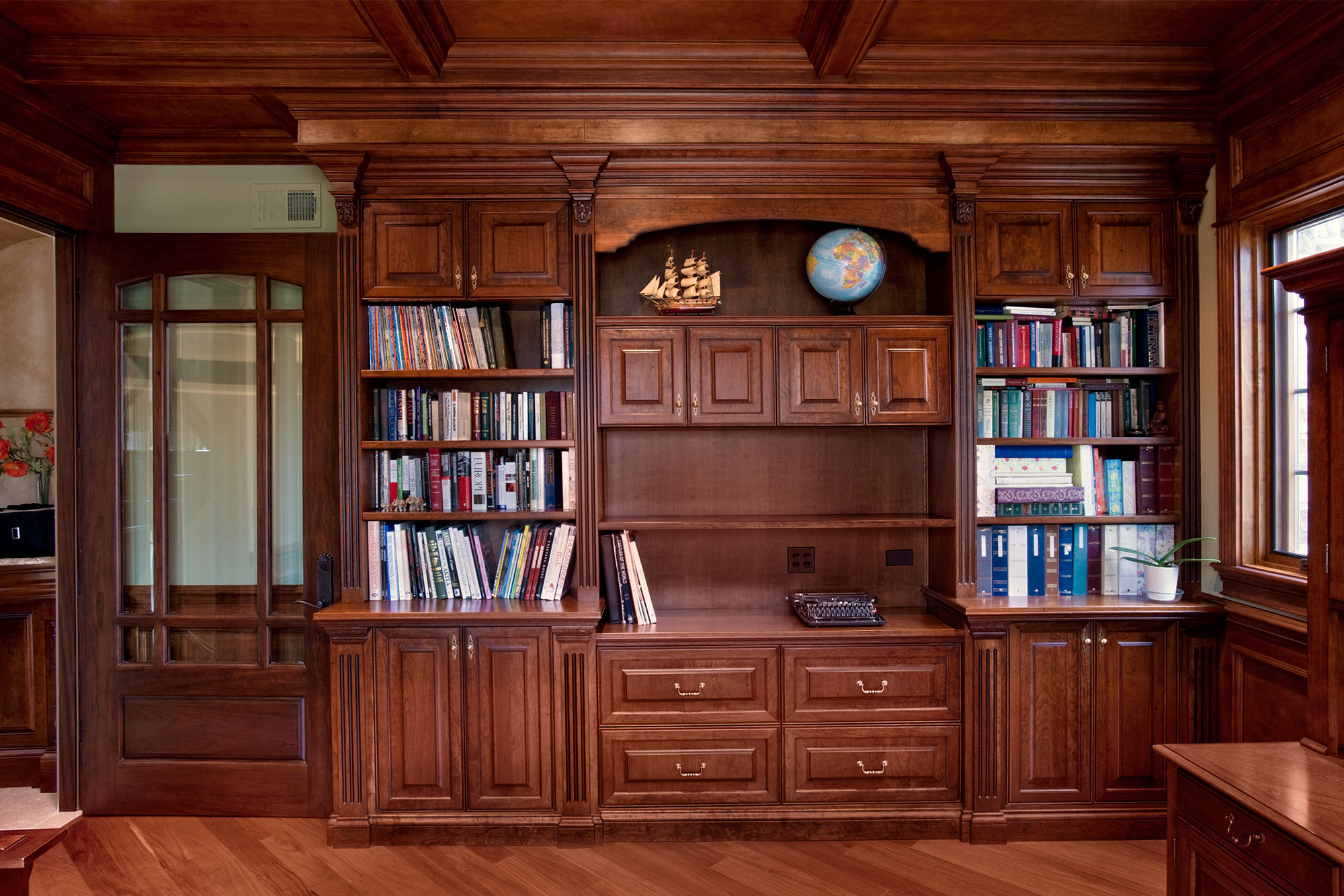 custom solid wood library cabinetry with prarie style door french