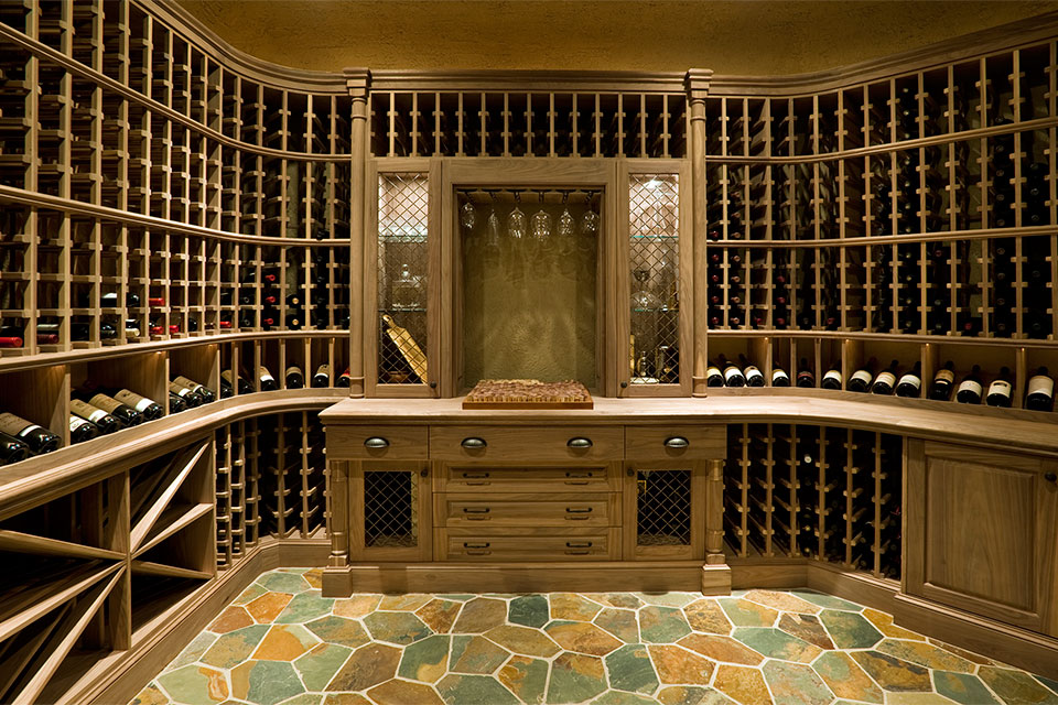 Custom Wine Cellar - Wine centerpiece with glassware display and cabinetry showcasing carved millwork  Pleasant Ln., Glenview, Glenview Haus Photo Gallery, Chicago